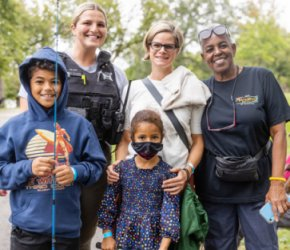 Chicago Police and Firefighters Help Local Youths Catch Their First Fish
